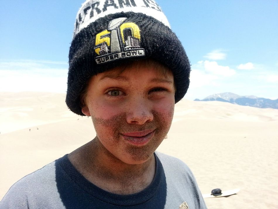 One of the kids at my church after being buried in the sand. I love his Sand Beard and Expression. Natural Light Portrait Boy Playing In The Sand Buried In Sand Great Sand Dunes Sand And Sun Wink Elfish