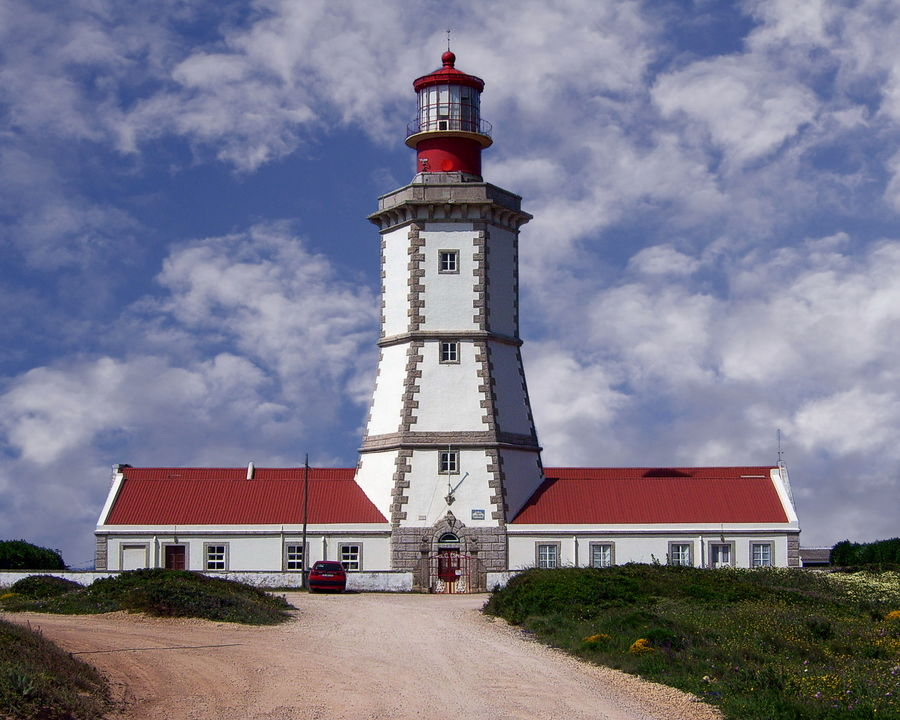 The Cape Espichel Lighthouse dates back to 1790 - Azores Architecture Building Exterior Built Structure Clock Clock Tower Cloud - Sky Day Espichel Lighthouse No People Outdoors Sky Tower