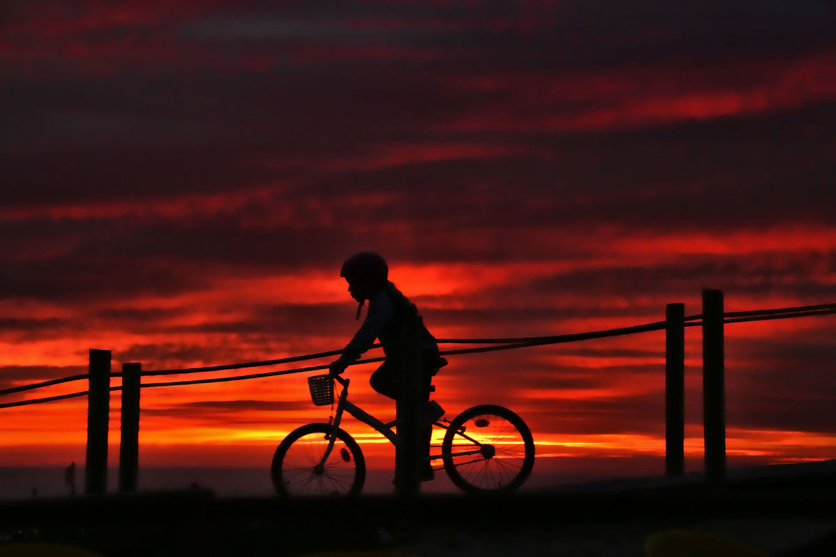 Bedtime stories Bicycle Cloud Cloud - Sky Cycling Dramatic Sky Full Length Kid On Bike Kids Land Vehicle Men Mode Of Transport Mother Mother Telling Stories Orange Color Riding Scenics Silhouette Sky Sunset Sunset Portugal CyclingUnites
