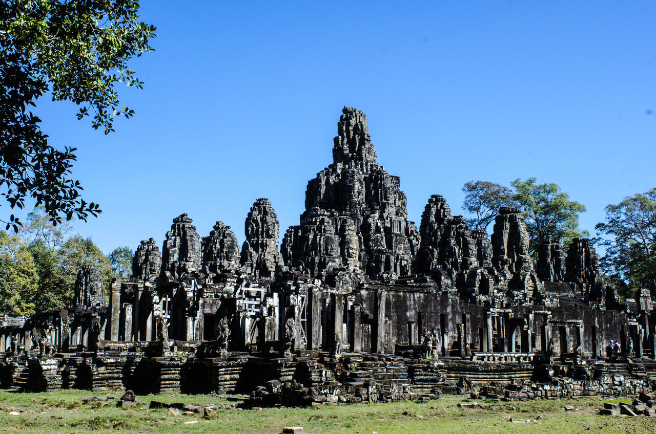 Angkor Thom Ancient Angkor Angkor Thom Angkor Wat Architecture Cambodia Castle Character Day No People Outdoors Siem Reap Stone Statues Travel Destinations Travel Photography Tree