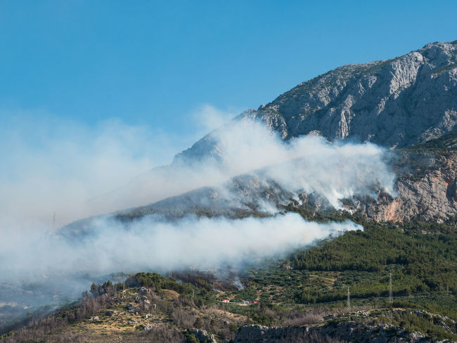 Large forest fire below mountain Biokovo Burn Burning Croatia Danger Day Fire FireFighting  Flame Forest Landscape Large Makarska Mountain Mountains Nature No People Outdoor Outdoors Scenics Smoke Wind