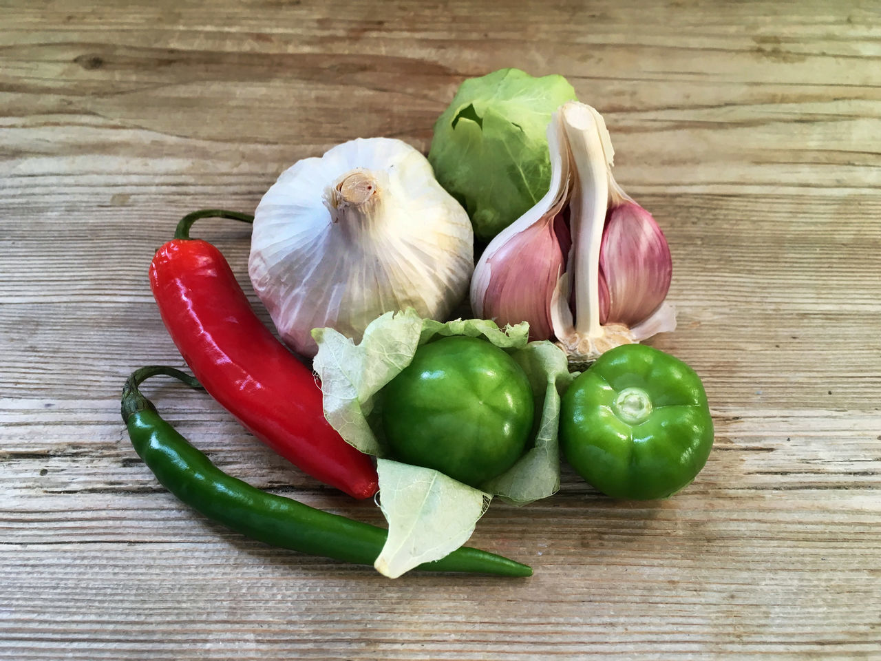 Chillies Chopped Food Food And Drink Freshness Garlic Green Chillies Healthy Eating Hot Sauce Ingredients Mexican Culture Mexican Food Mexican Husk Tomato No People Red Chili Pepper Salsa Salsa Verde Still Life Table Tomate Tomatillo Tomatillos Tomato Vegetable Wooden