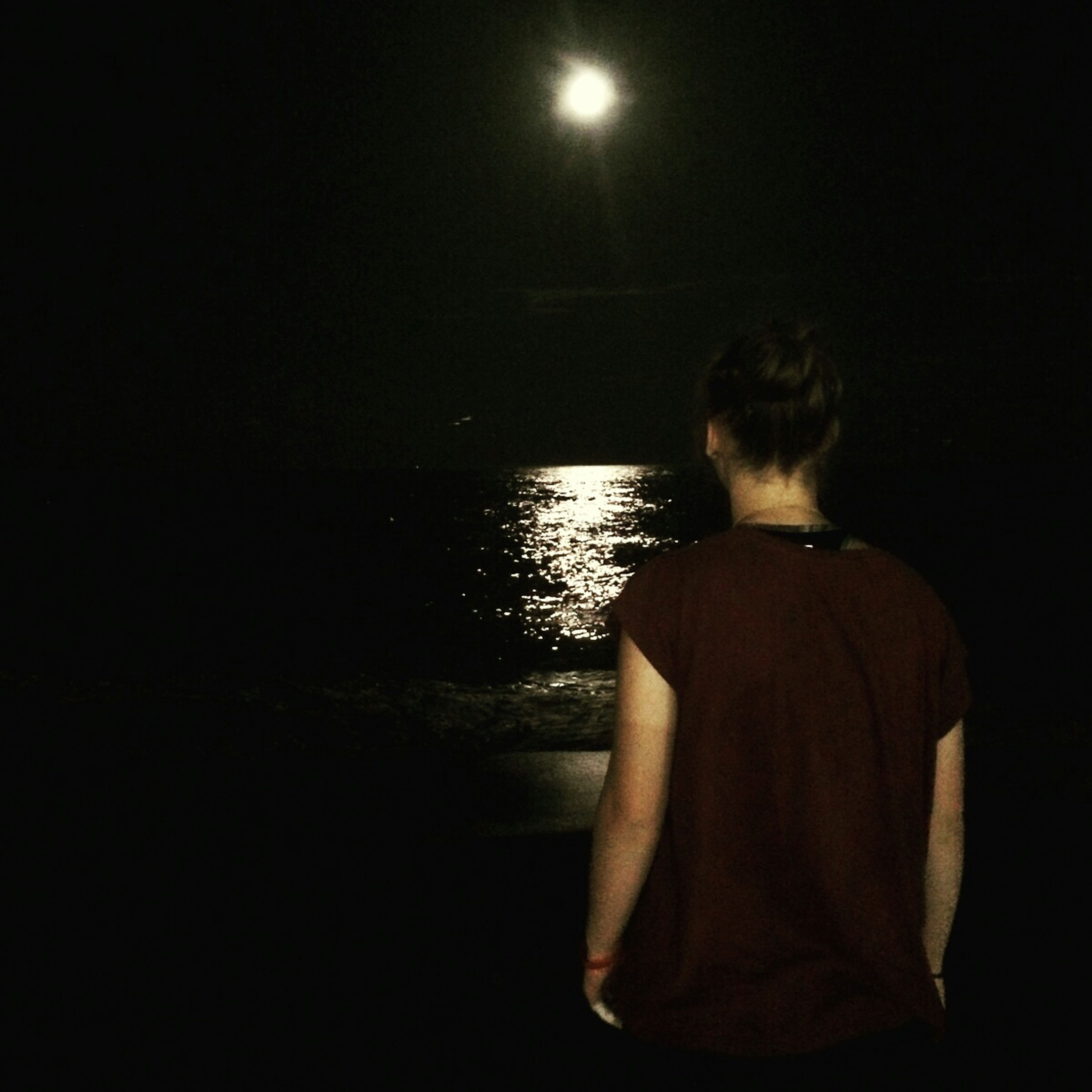 night, standing, lifestyles, dark, illuminated, leisure activity, rear view, copy space, casual clothing, water, person, full length, three quarter length, waist up, silhouette, contemplation, side view, men