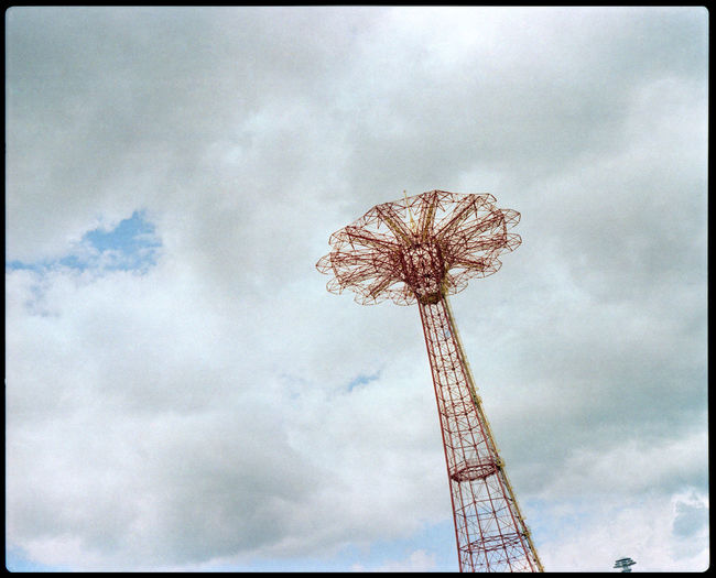Life, simulated at Coney Island Amusement Fair Analogue Photography Architecture Beach Life Boardwalk Empire Clouds Over Beach Coney Island / Brooklyn NY Dramatic Sky Life Moon New York Plaubel Makina 67 USA Artificial Palm Beach Architecture Coney Island Coney Island Beach Grain Medium Format New York Beaches Proud Bird Radiant Sand Seagull Xpro
