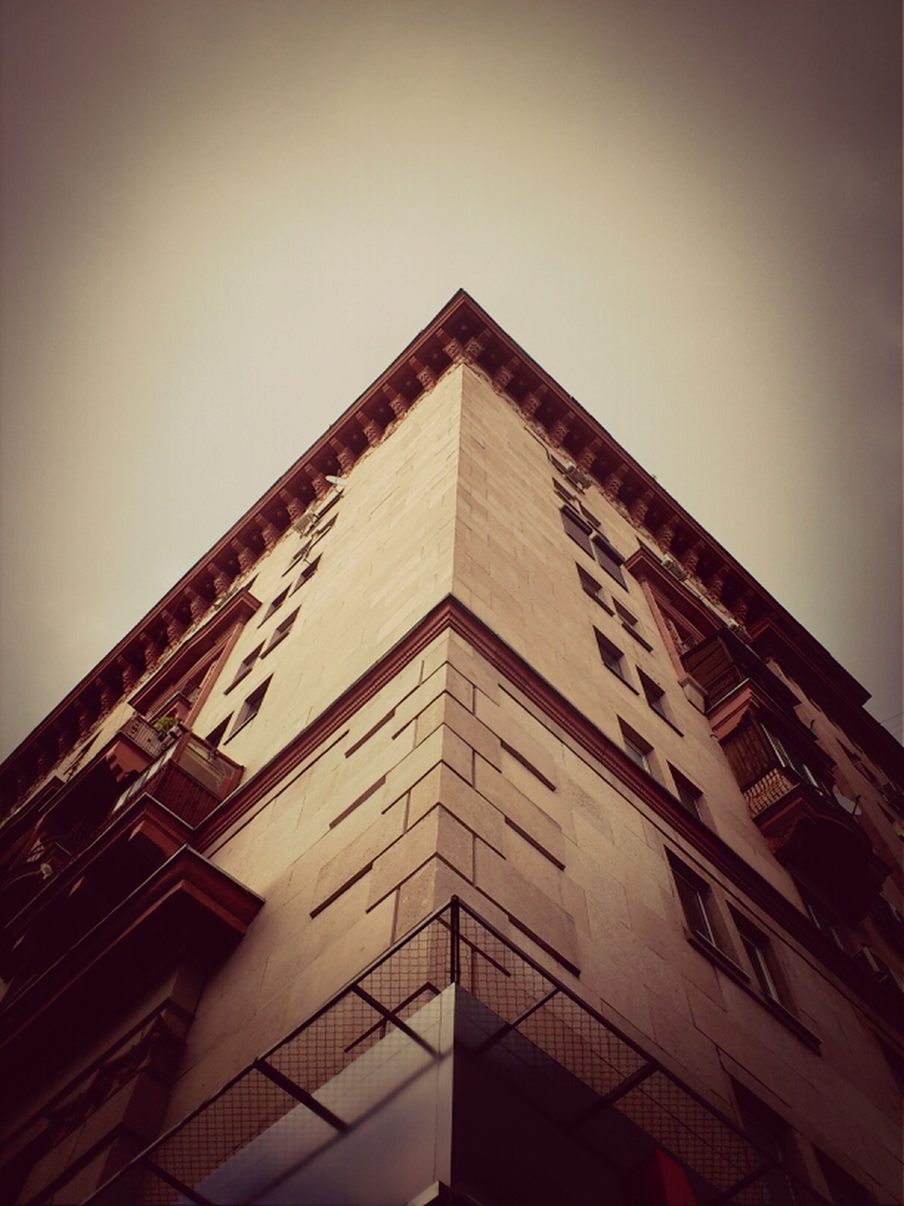 architecture, built structure, low angle view, building exterior, clear sky, building, sky, high section, window, residential structure, outdoors, city, no people, residential building, day, tower, copy space, tall - high, house, auto post production filter