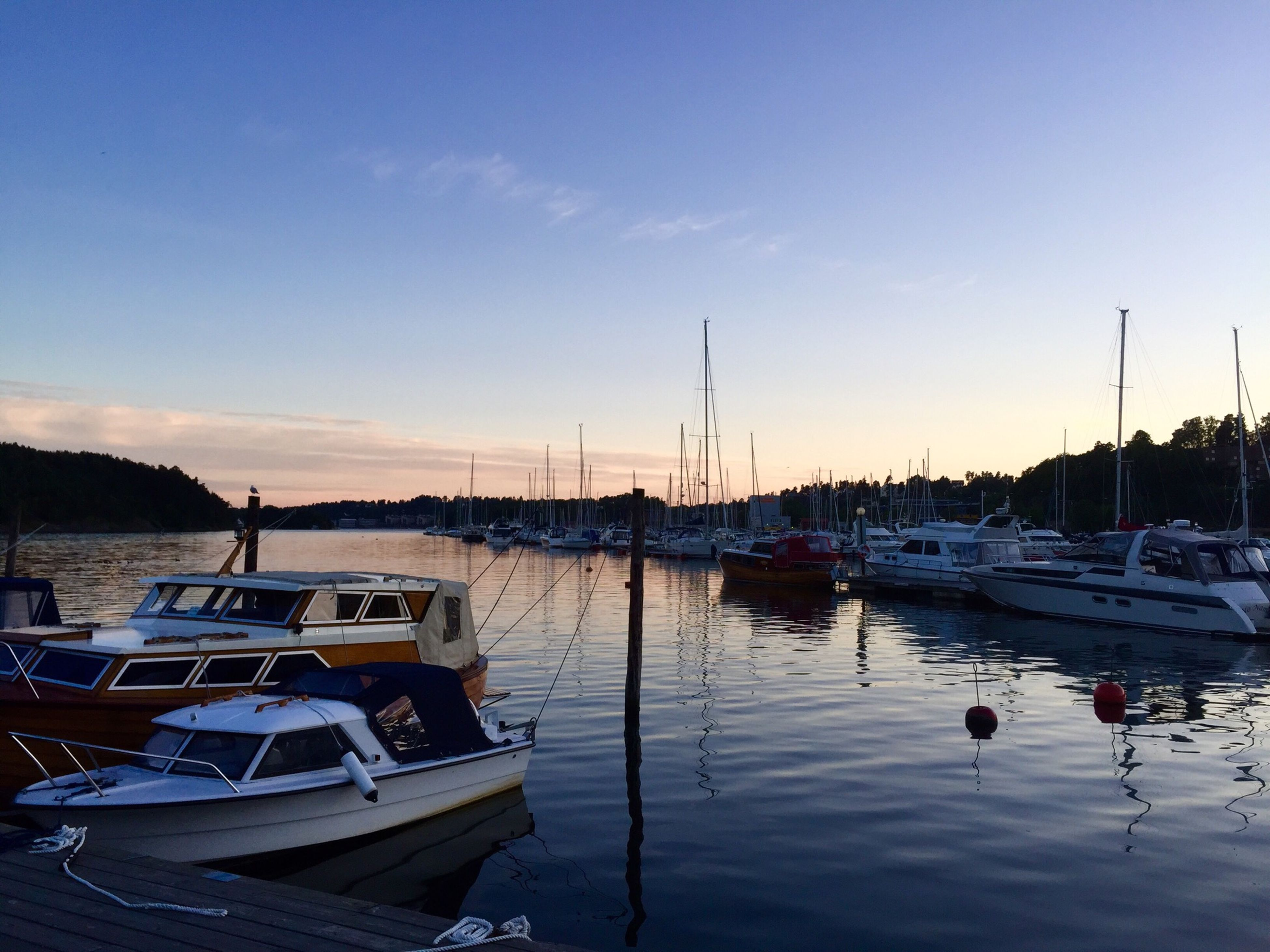 nautical vessel, transportation, mode of transport, moored, boat, water, mast, harbor, sky, sunset, reflection, sailboat, travel, waterfront, blue, nature, marina, tranquility, outdoors, beauty in nature
