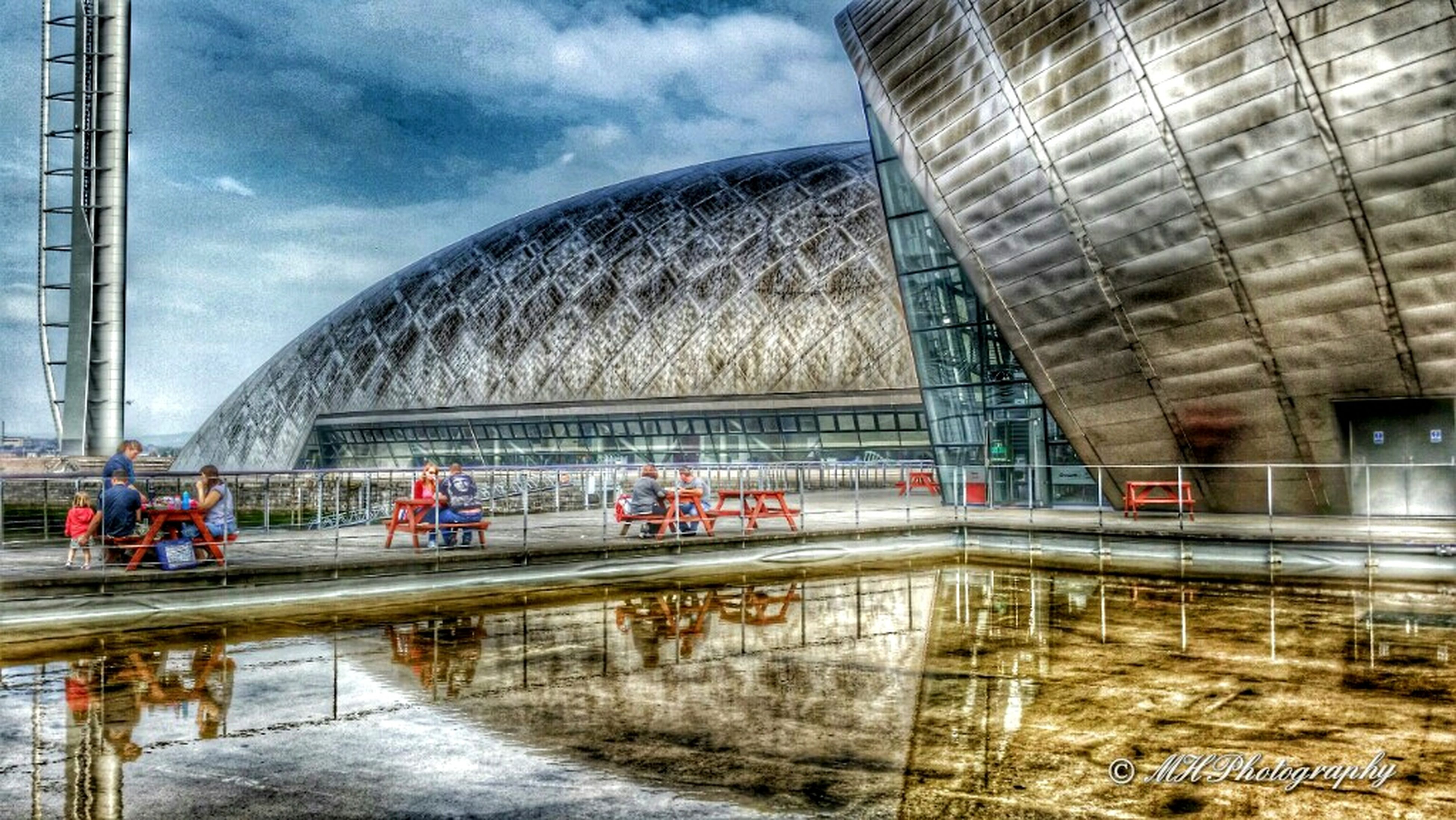 architecture, built structure, building exterior, sky, bridge - man made structure, water, transportation, connection, city, cloud - sky, reflection, river, travel destinations, travel, arch, modern, famous place, engineering, incidental people, rail transportation