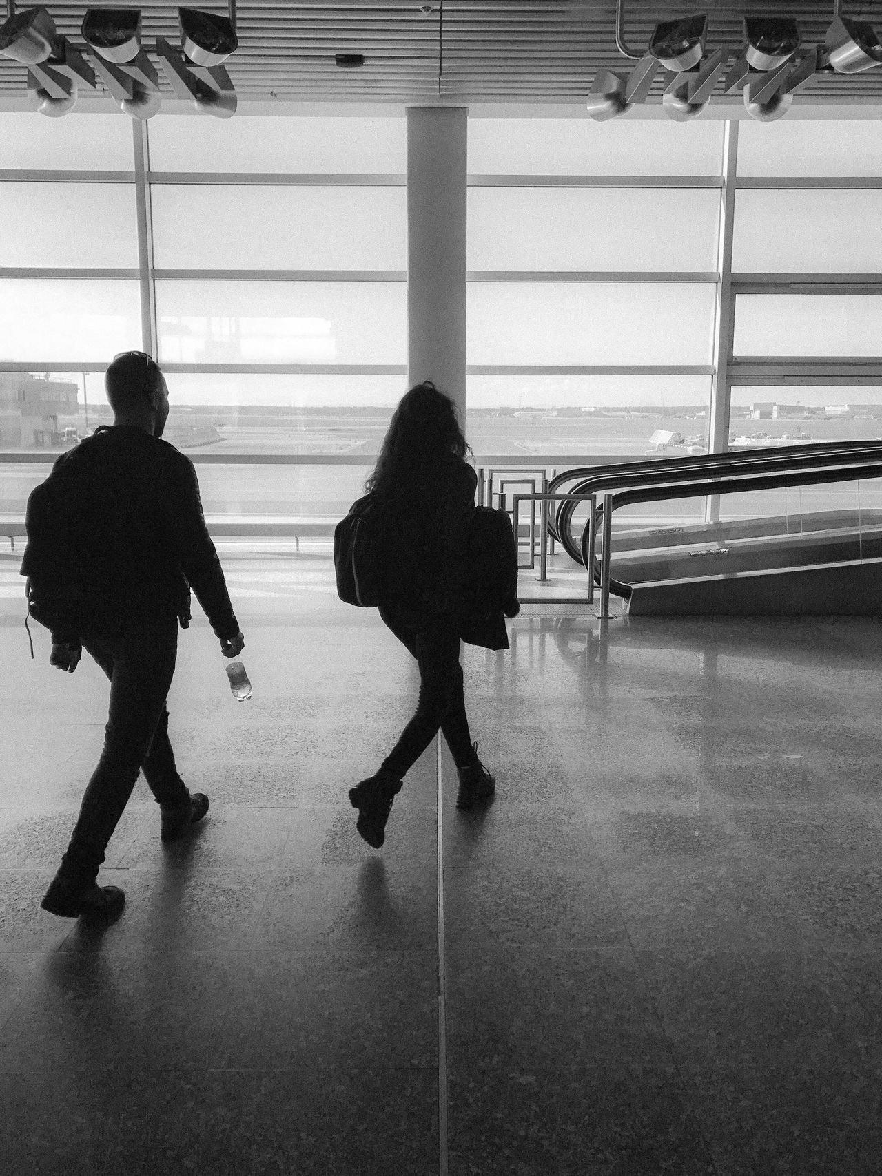 The Street Photographer - 2017 EyeEm Awards Indoors  Full Length Two People Real People Women Rear View Men Standing Airport Departure Area Adult Architecture People Day Adults Only Bnw