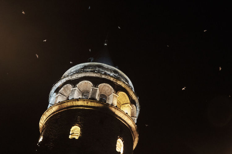 Birds In The Sky Galata Tower Galata Tower By Night Idaots Illuminated Low Angle View Night Travel Travel Destinations Travel Photography Traveling Travelling Travelphotography