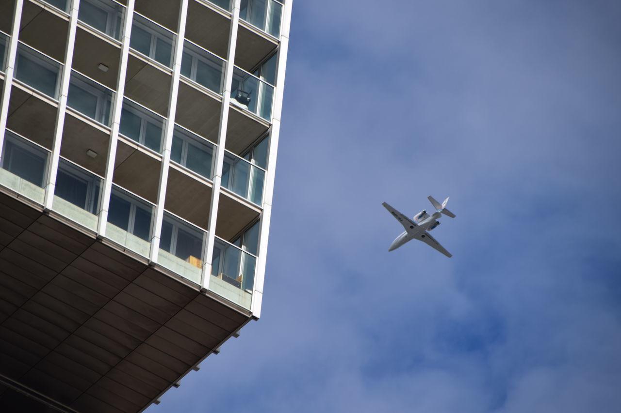 Plane Rotterdam Airplane Blue Building Cloud - Sky Day Flying Low Angle View Sky Wilhelminapier Window