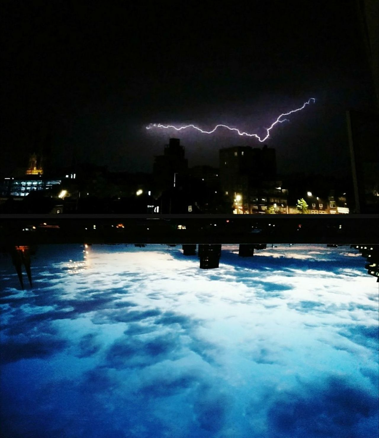 Night Lightning Illuminated Weather Storm Cold Temperature Thunderstorm Power In Nature Sky Cloud - Sky Storm Cloud Outdoors Nature Forked Lightning Water Beauty In Nature City Cityscape Dimension Dimensions Dimensions Intersection Day And Night Day And Night Photography Dreamy Electricity