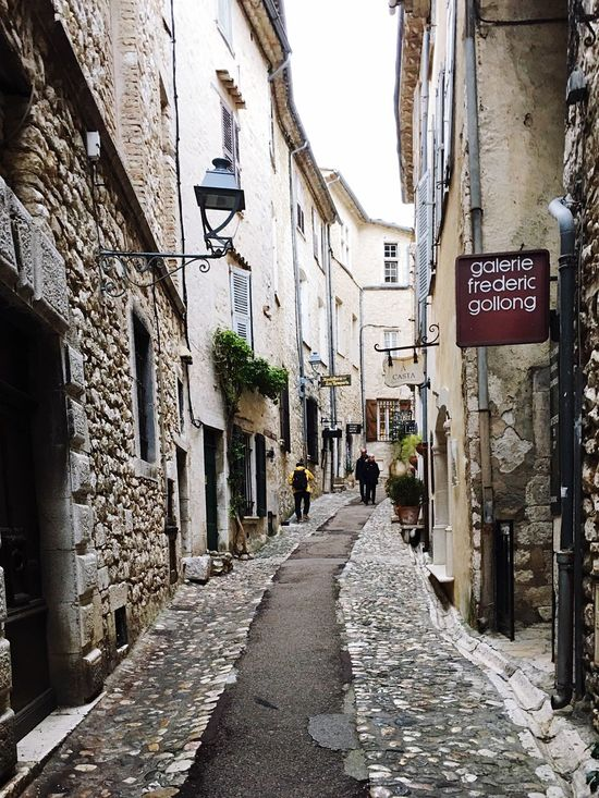 Architecture City The Way Forward Road Sign Outdoors People Sky Day Adult Adults Only City Store Window Built Structure Classic Old Buildings Saint Paul De Vence EyeEm Gallery EyeEm Best Edits EyeEm Best Shots EyeEmBestPics