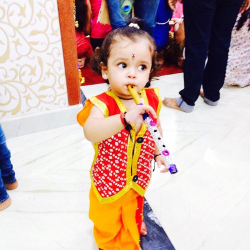 Little kahna Kanihya Krishna Laddu Gopal Kanha Playing Music Bachpan Kids Kids Being Kids Kidsphotography Innocence Childhood Looking At Camera Cute Baby Multi Colored People