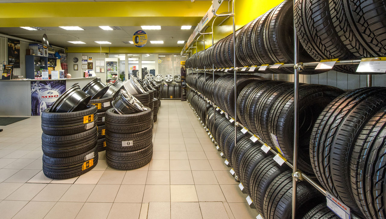Russia, Moscow, transport, cars, wheels, tyres, car service, trade Tyres Arrangement Car Service Cars Day In A Row Indoors  Industry Large Group Of Objects Moscow No People Retail  Russia Shelf Stack Store Trade Transport Wheels Wine Cask