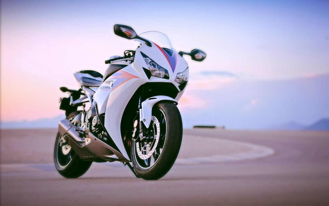 transportation, land vehicle, motorcycle, mode of transport, outdoors, sunset, no people, stationary, road, sky, day, close-up