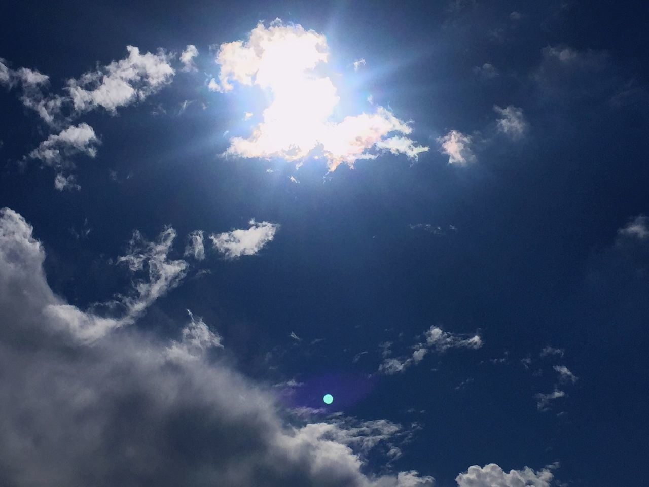 sky, cloud - sky, nature, beauty in nature, sunbeam, low angle view, scenics, sky only, sun, blue, tranquility, environment, sunlight, tranquil scene, outdoors, no people, backgrounds, ethereal, day