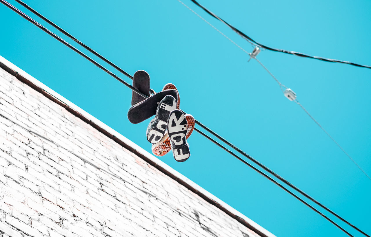 Shoestrings. Adventure Blue Sky Cable California Fujifilm Fujinon Hanging Low Angle View No People Outdoors Roadtrip San Francisco Shoes Sneakers Streetphotography Strings Travel Travel Photography Urban USA Vacations Wanderlust Wide Angle Wires X-T10 Out Of The Box