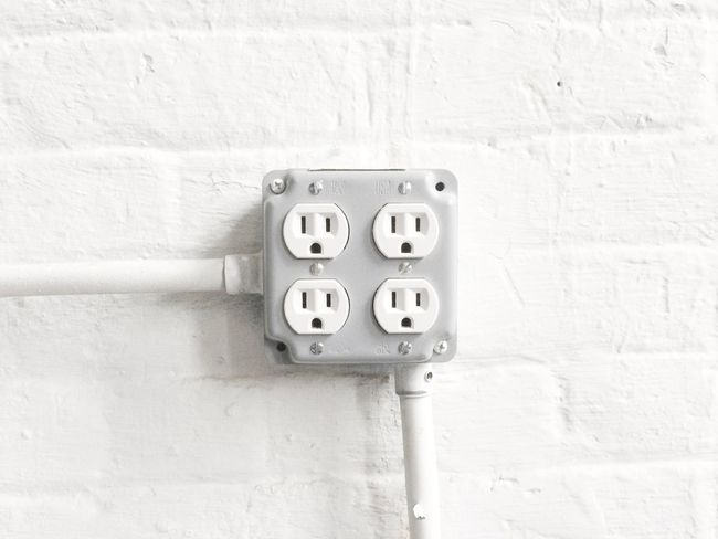 Plug in. New York City, USA. Photo by Tom Bland. Close-up Interior IPhone IPhoneography Indoors  Detail Wall Plug Plugs Outlet Electricity  Electric Power Energy Plug In Copy Space Minimal No People Outdoors Day Horizontal Unplugged Consumption  Sockets Wall Socket
