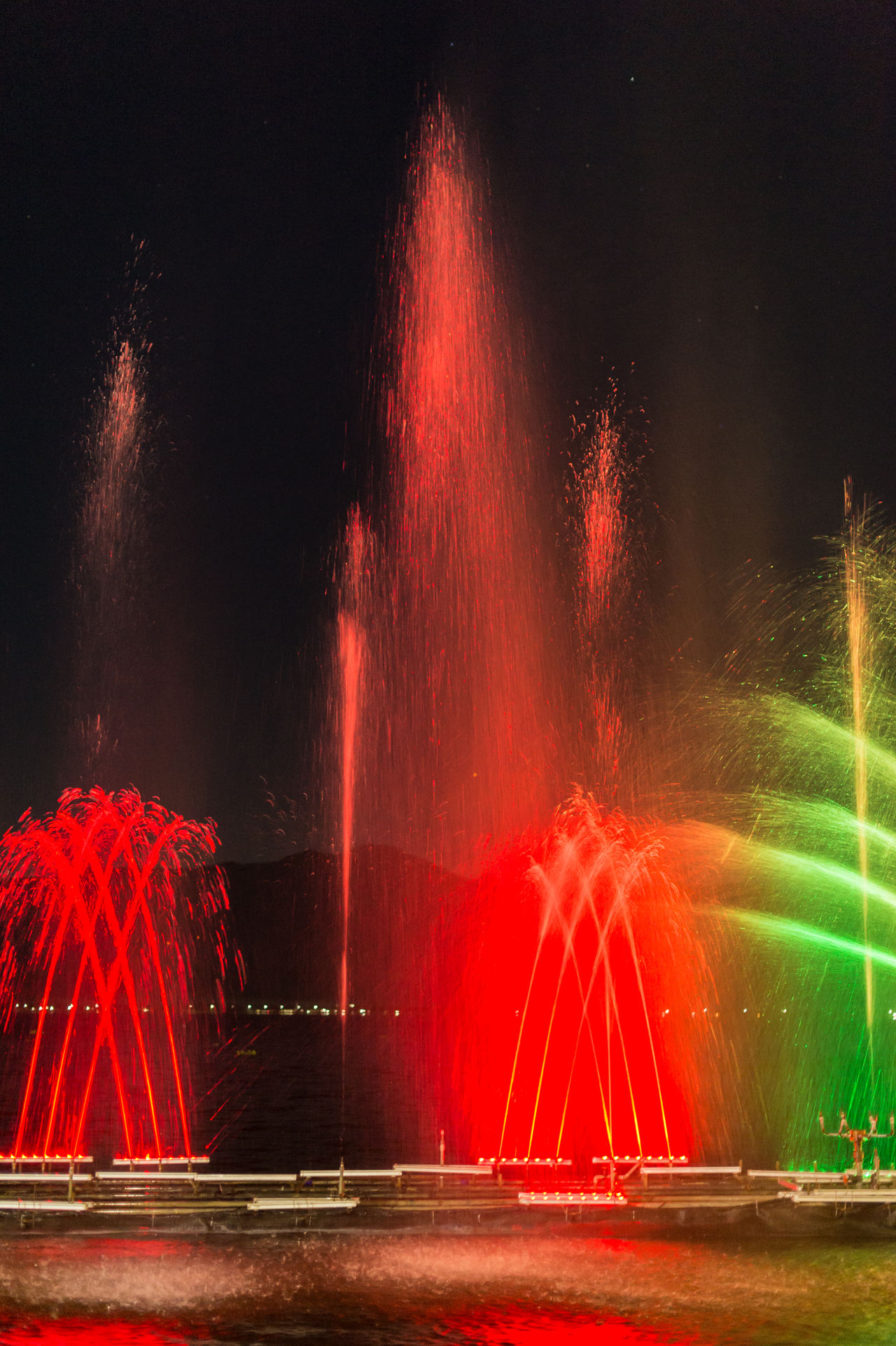 Blurred Motion Exploding Glowing Illuminated Light Trail Long Exposure Motion Multi Colored Night No People Outdoors Red Sky Speed Spraying Water