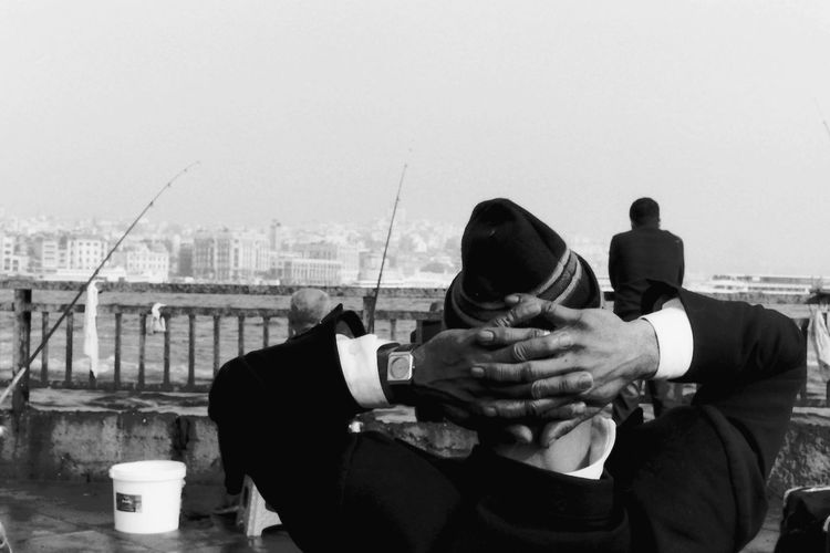 Analogue Photography B&w Street Photography Blackandwhite City Day Fishing Hands Hut Lifestyles Meditation Outdoors Real People Relax Relaxation Relaxing Sea Sea And Sky Seascape Sitting Streetphotography Warm Clothing