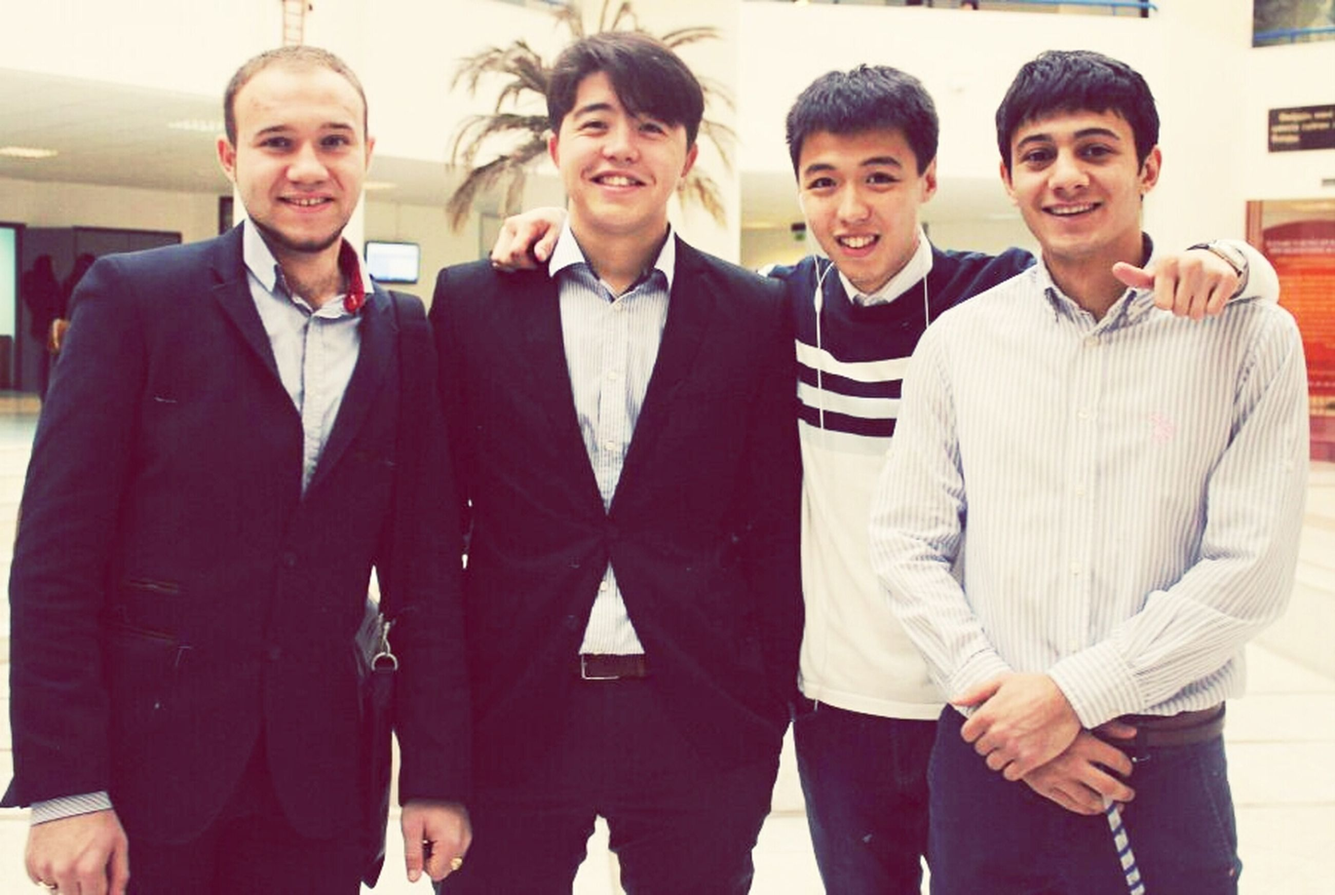 togetherness, lifestyles, young men, leisure activity, bonding, front view, portrait, casual clothing, friendship, standing, person, looking at camera, young adult, love, indoors, smiling, happiness, men