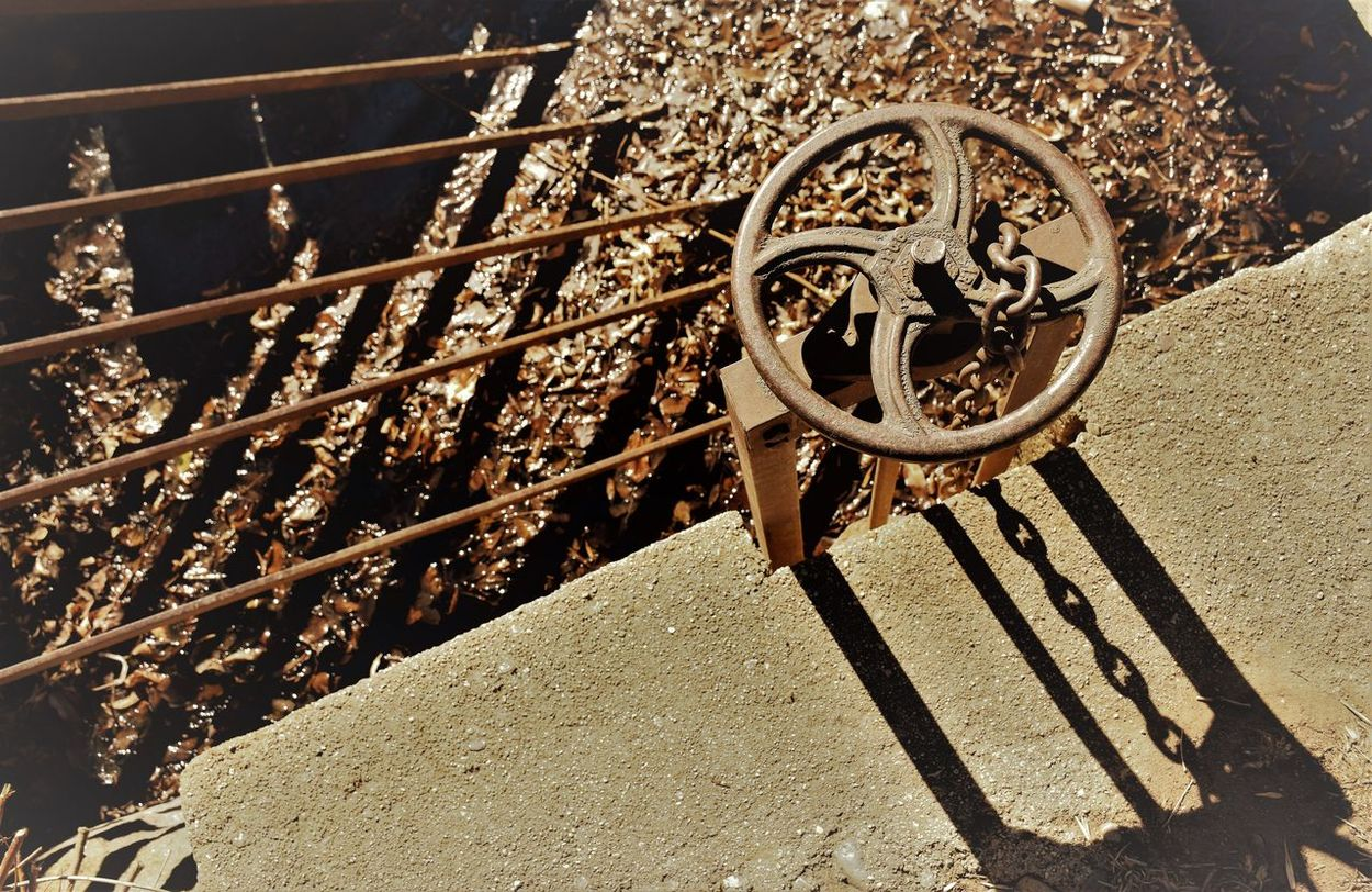 Grid Pattern Metal Metal Wheel No People Outdoors Overflow Rusty Metal Shadow Cast Sunlight Valve Wheel