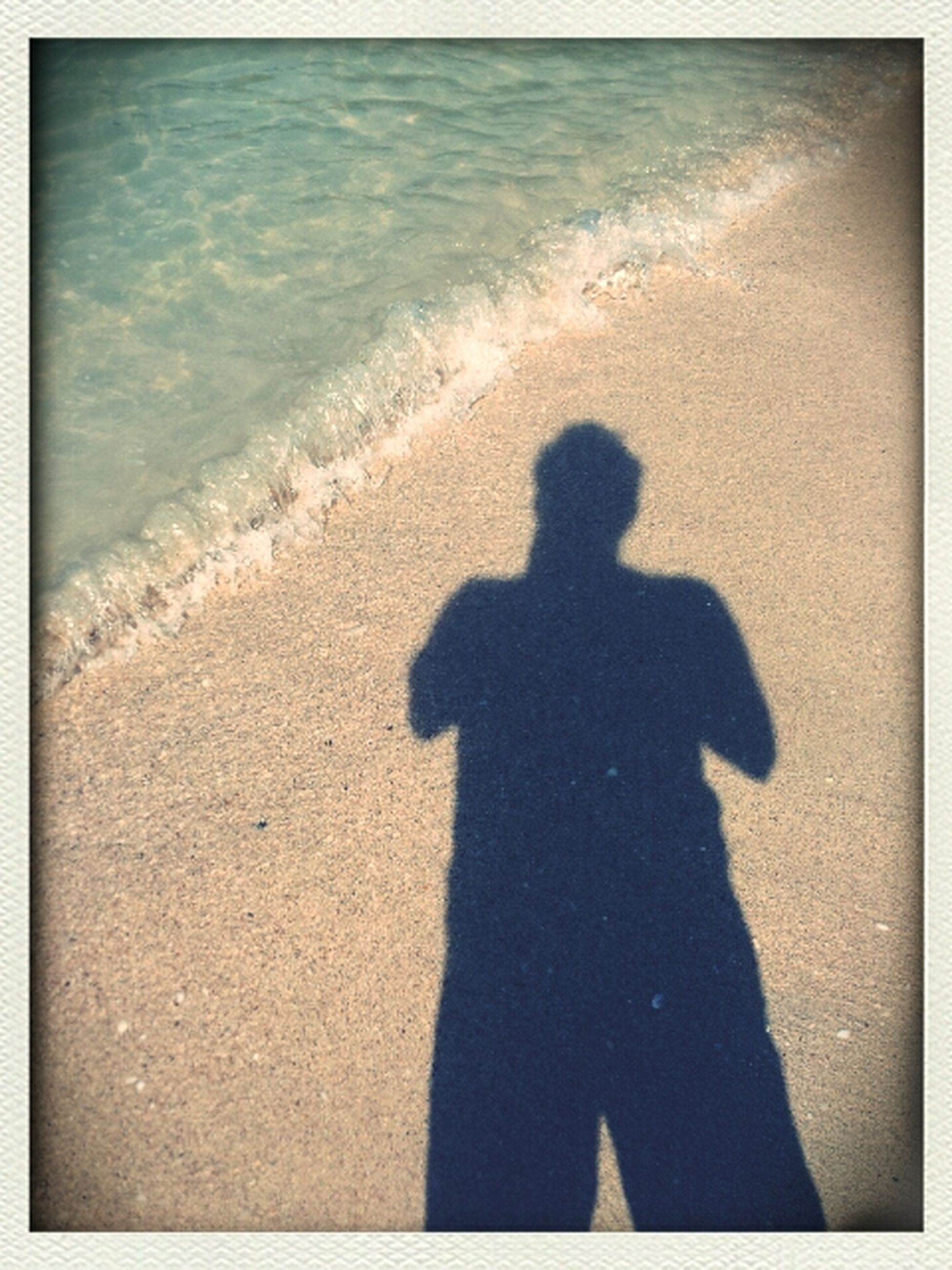 sea, silhouette, beach, transfer print, shadow, water, shore, men, auto post production filter, leisure activity, sunlight, lifestyles, horizon over water, sand, high angle view, standing, unrecognizable person