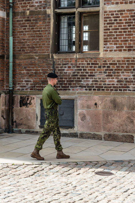 Soldiers guarding the gate of Rosemborg Castle in Copenhagen Architecture Army Army Life Army Soldier Brick Wall Building Exterior Built Structure Camouflage Clothing Castle Day Denmark Full Length Guard Guardian Guards Military Military Uniform One Person Outdoors Protection Real People Royal Royal Palace Standing Terrorism