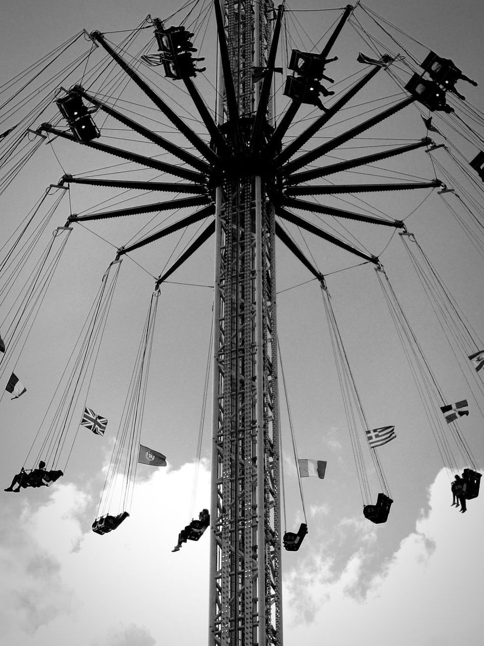 Amusement Park Arts Culture And Entertainment Amusement Park Ride Sitting Outdoors Moment Blackandwhite Quiet Moments Blackandwhite Photography Large Group Of People Themepark HaveFun Eyeemphotography From My Point Of View Todayphotography Blackandwhitephotography Freedom Art Photography Flying Clouds And Sky Motion Eye4photography  Beautifulview Eye4photography  EyeEmBestPics