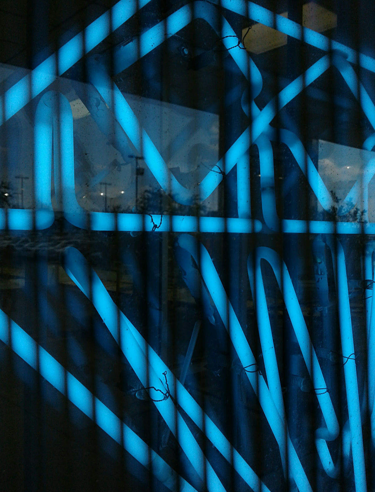 Close-up of blue neon light tubes through metal window bars. Bars Blue Close-up Darkness And Light Geometric Geometric Abstraction Glow Illuminated Lights Lines Neon Night No People Urban