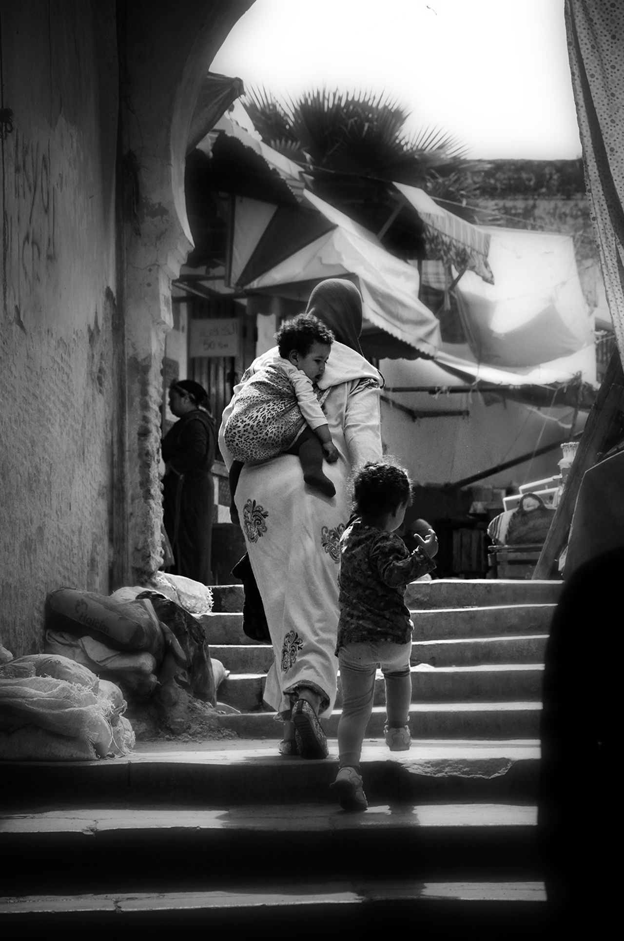 Women Around The World Women Who Inspire You Motherhood Streetphotography Motherhood Moments Togetherness Women Of EyeEm Woman Power Blackandwhite Photography Local Culture Childhood Mother & Daughter Daily Life Real People Blackandwhite - Medina De Fez Fez Morocco Africa