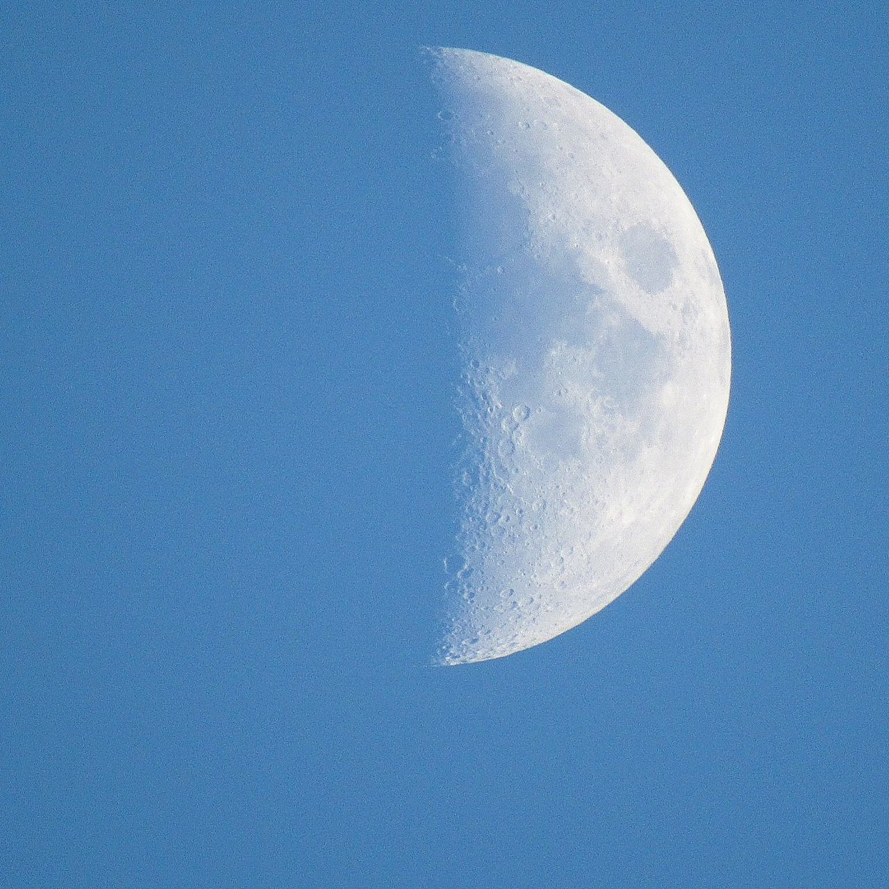 moon, clear sky, low angle view, blue, nature, beauty in nature, copy space, moon surface, tranquil scene, no people, astronomy, half moon, outdoors, tranquility, sky, scenics, day, space exploration, space, crescent