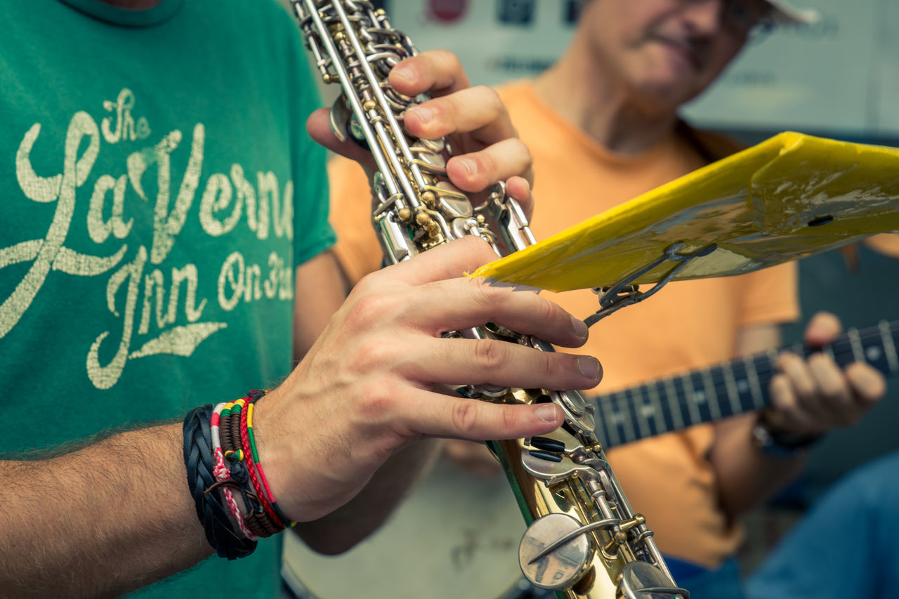 Adult Bracelet Chiavenna Close-up EyeEm Team Guitar Human Body Part Human Hand Italy Men Music Music Music Festival Musical Instrument Musician Playing Real People Saxophone Skill  TakeoverMusic Two People Waiting Game