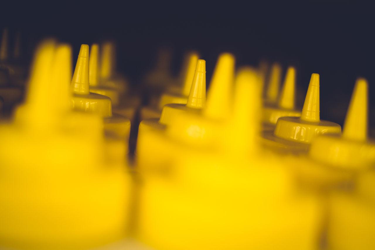 Close-Up Of Mustard Bottles