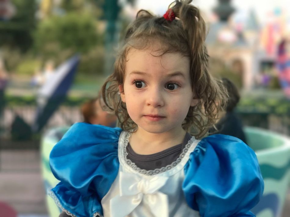 Alice In Wonderland Disneyland Portrait Looking At Camera Childhood Real People Innocence Focus On Foreground Cute Headshot One Person Close-up Front View Outdoors Day People