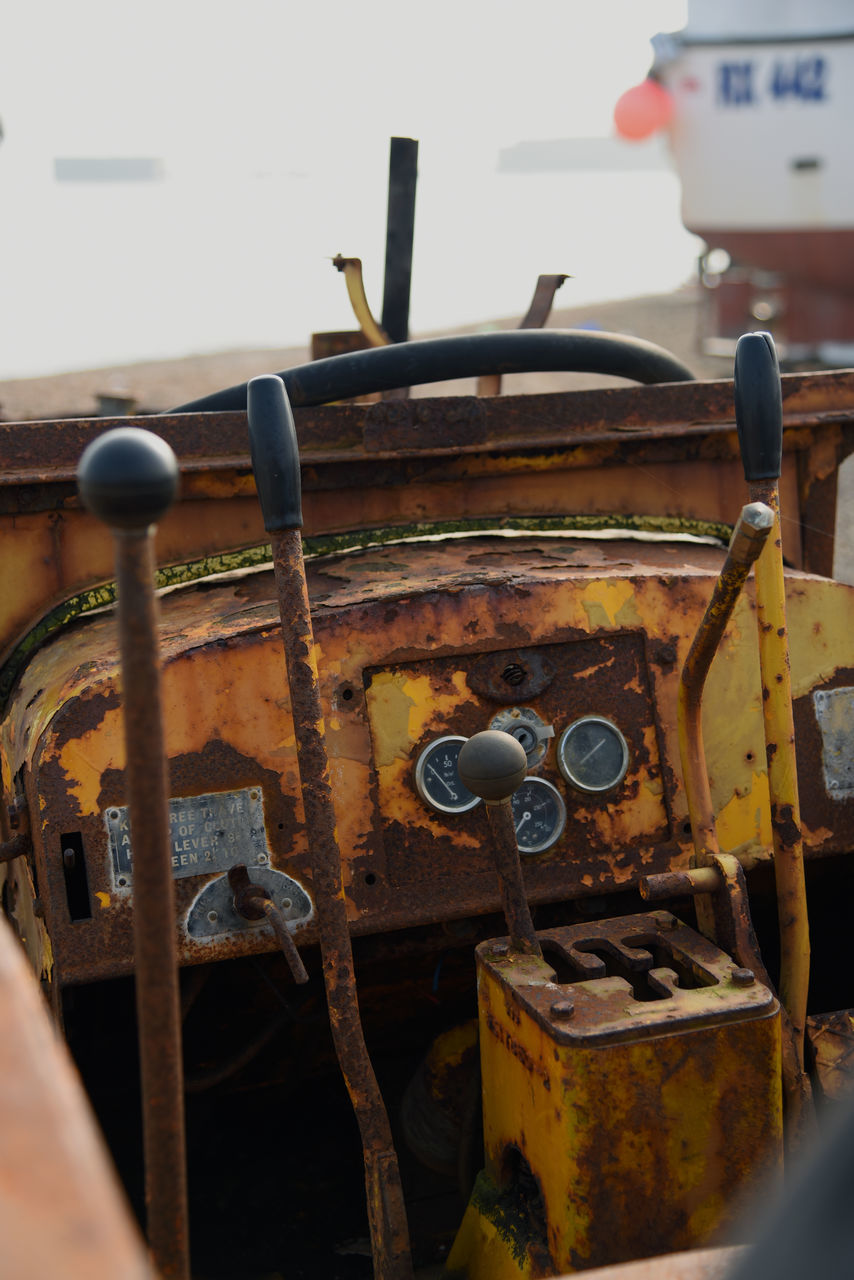 metal, rusty, mode of transport, abandoned, day, transportation, close-up, no people, steering wheel, outdoors, nautical vessel, gauge