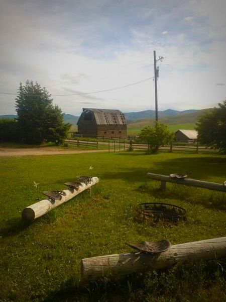 Architecture Grass Built Structure Sky History No People Day Nature Tree Outdoors Barn Firepit Seats In Row Railroad Ties