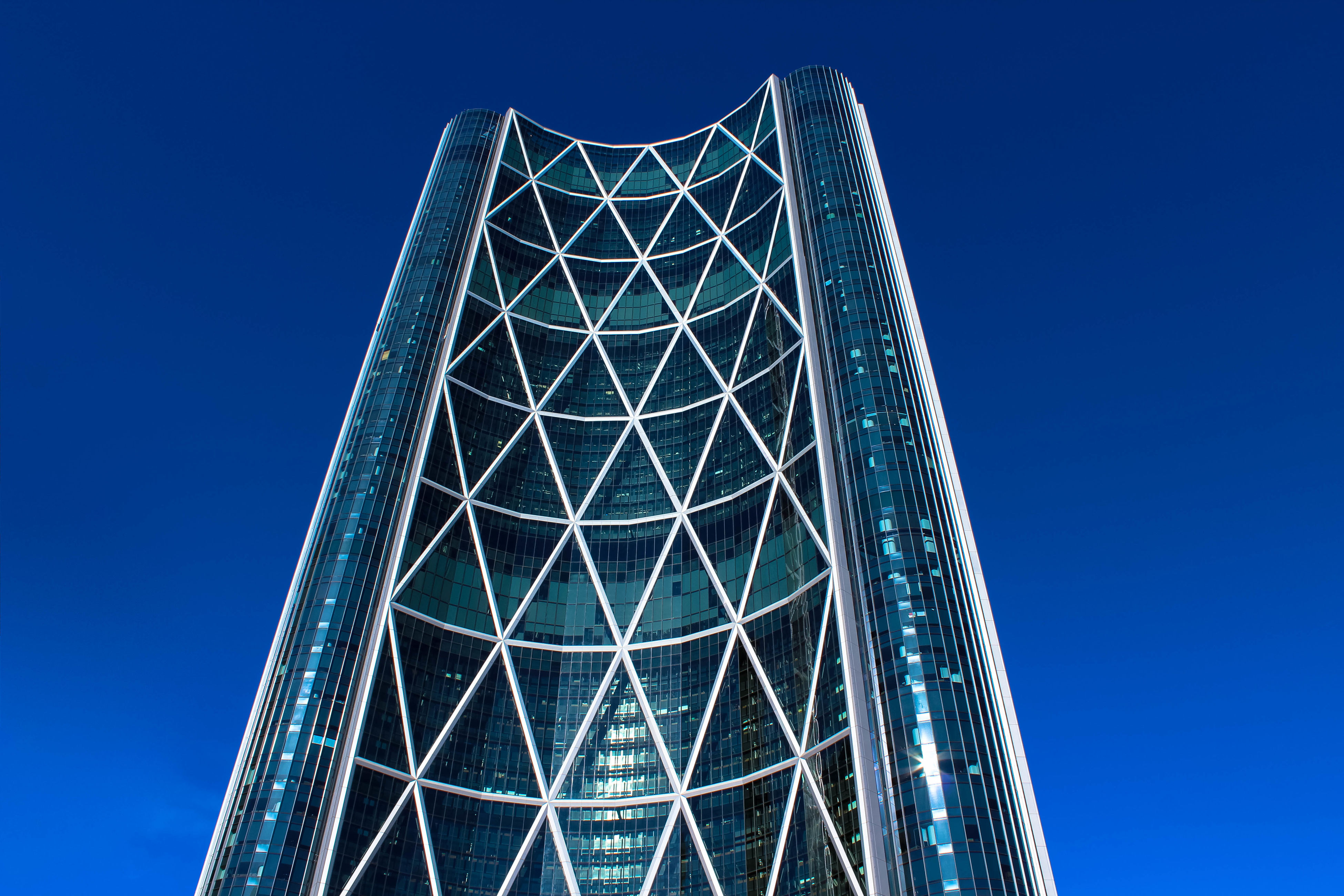 blue, architecture, low angle view, built structure, clear sky, modern, no people, day, building exterior, outdoors, sky, illuminated, city
