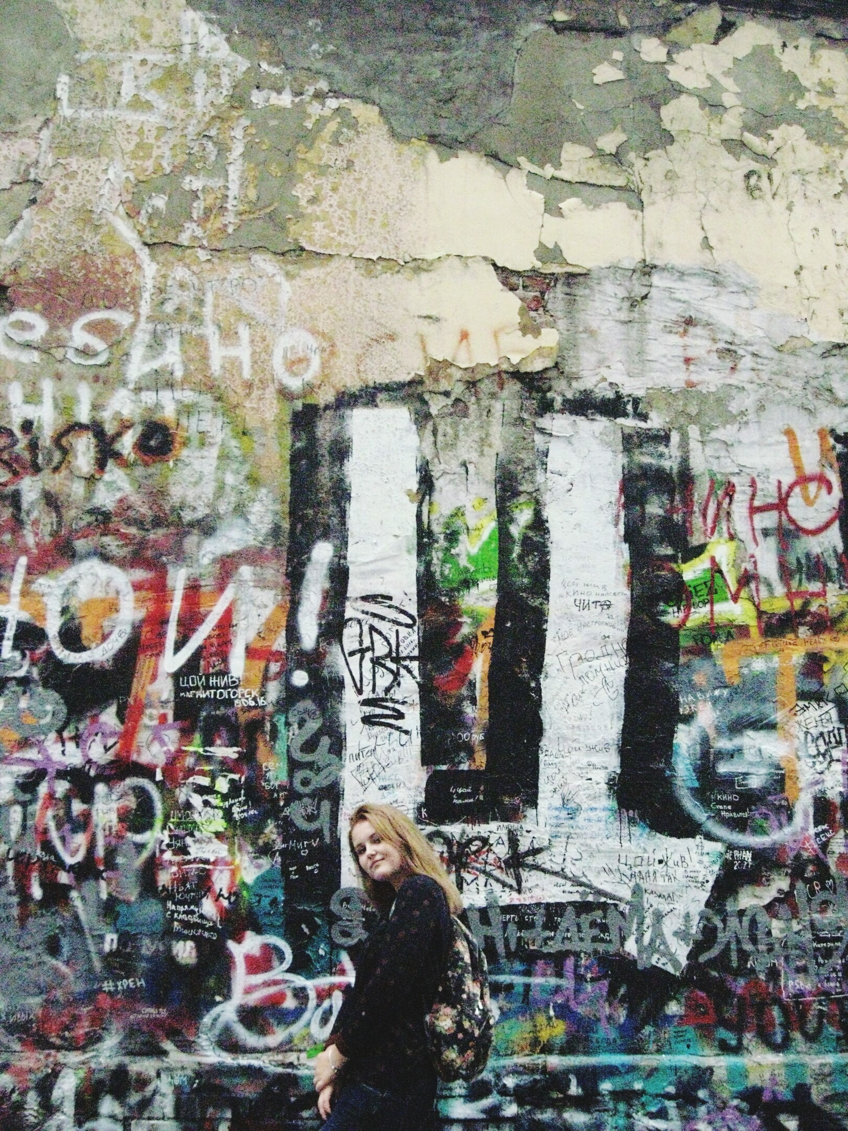 graffiti, wall - building feature, lifestyles, art, art and craft, men, leisure activity, standing, creativity, casual clothing, person, multi colored, outdoors, street art, day, full frame