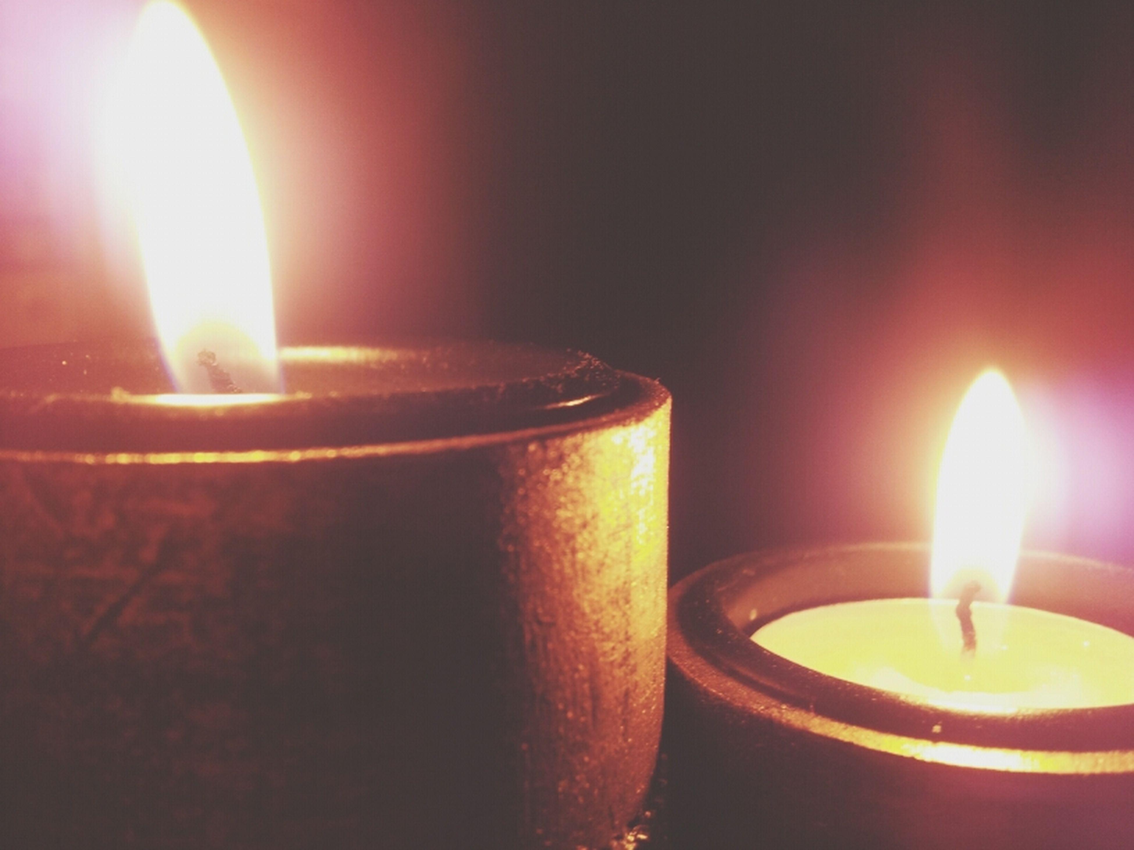 flame, burning, heat - temperature, glowing, candle, fire - natural phenomenon, illuminated, indoors, close-up, lit, candlelight, light - natural phenomenon, fire, still life, orange color, no people, tea light, lighting equipment, dark, focus on foreground