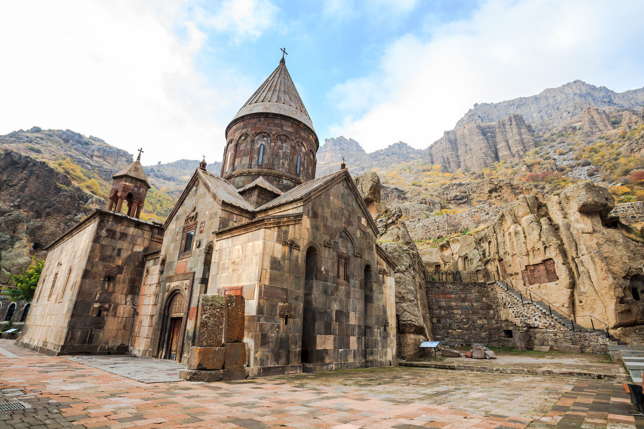 Monastery of Geghard is an Orthodox Christian monastery located in Kotayk Province of Armenia Christianity Church Monastery Ancient Ancient Civilization Architecture Beauty In Nature Building Exterior Built Structure Day History Low Angle View Mountain Nature No People Old Ruin Outdoors Place Of Worship Religion Scenics Sky Spirituality Temple Travel Destinations