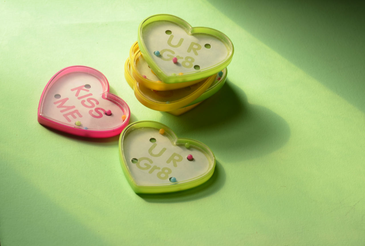 overhead view of a stack of plastic heart shape toy games with text Close-up Communication Day Game Heart Shape Heart ❤ Hearts High Angle View Indoors  Love ♥ No People Number Plastic Text Toys Valentine Valentine's Day