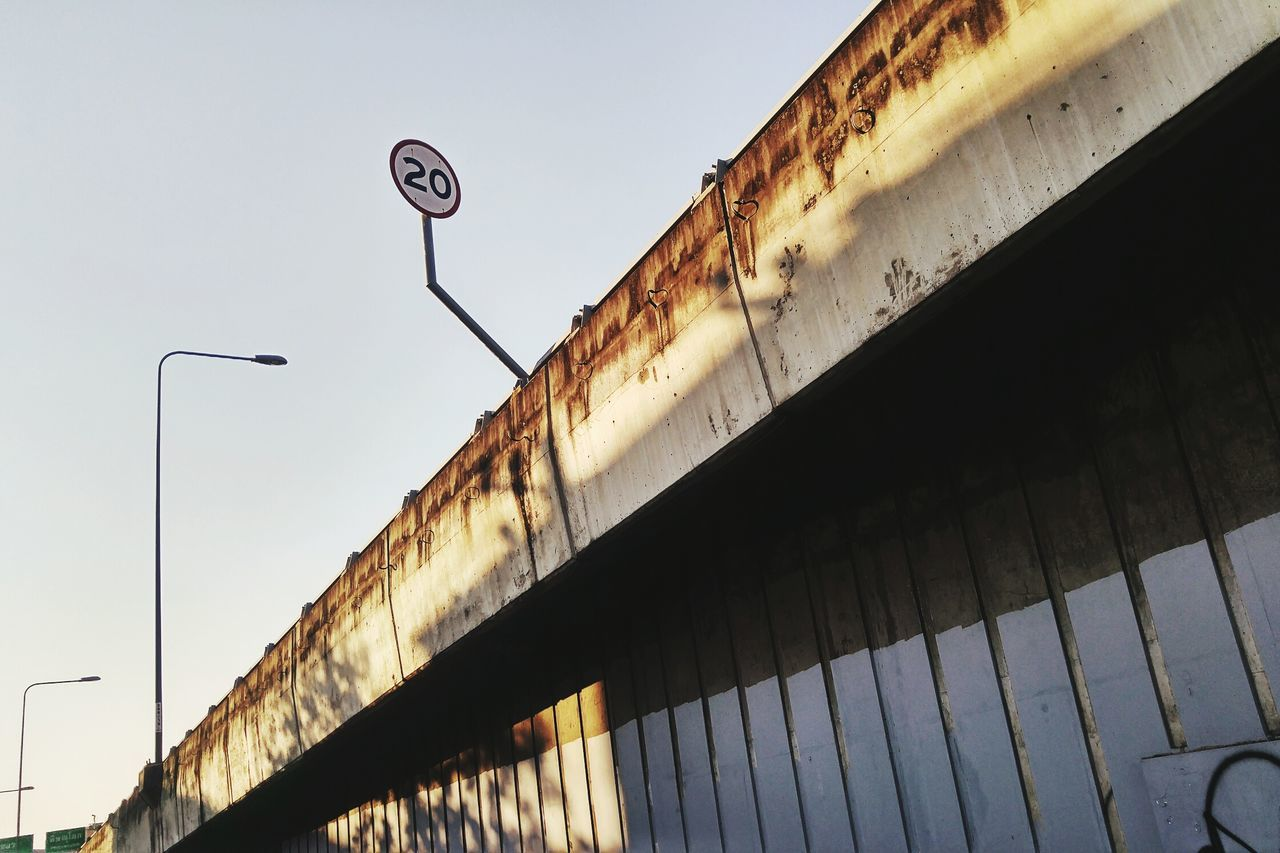 Side view of concrete bridge Side View Low Angle View Sky No People Outdoors Day Grunge Grungy GrungeStyle Concrete Bridge Structure Structures & Lines Perspective Road Street Traffic Lights Traffic Traffic Sign Weathered Dirty Speed Limit Sign Speed Limit Speed Limit 20 Transportation
