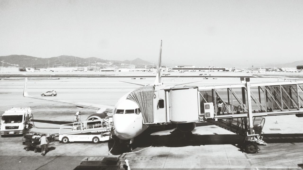 Transportation Mode Of Transport Sky Outdoors Day No People Passenger Boarding Bridge Aerospace Industry Commercial Airplane Industry Travel Business Finance And Industry Airport Runway Transportation Airplane Airport Black&white Black And White Collection  Blackandwhitephotography Black And White Black & White Blackandwhite Photography Blackandwhite