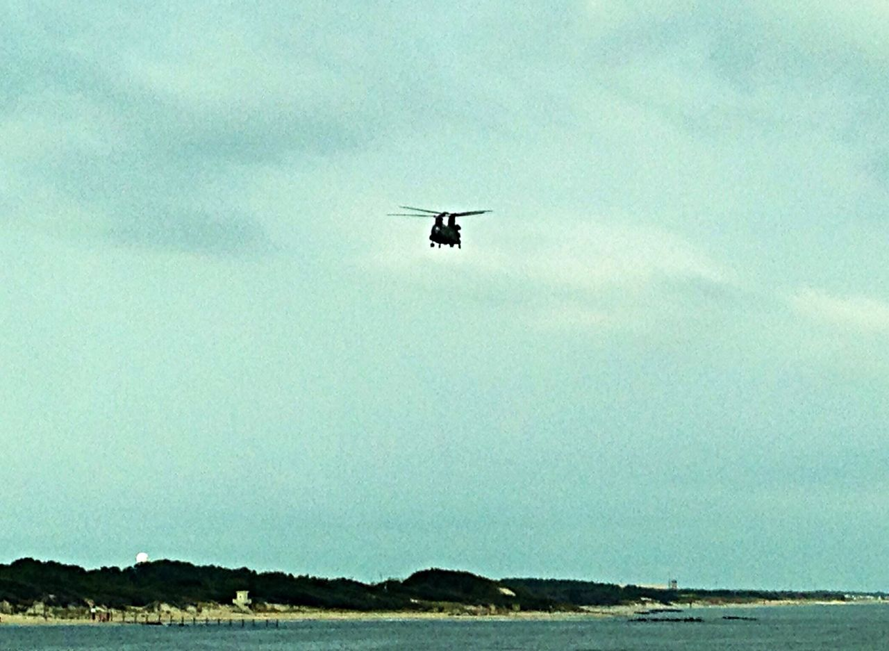 Another view of transport helicopter above the Chesapeake Bay Bridge-Tunnel. OBX14 Helicopter Flying