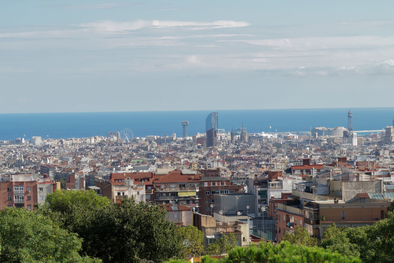 Barcelona, Spain Panoramic view from Nature Square at Park Guell Monumental Zone. The public park designed by Antoni Gaudi offers a wide view of Barcelona City. Antoni Gaudí Architectural Architecture Attraction Attraction Park Barcelona Barcelona, Spain Catalonia City Cityscape Design Gaudi Guell Guell Monumental Zone Mediterranean  Mediterranean Sea Modernism Nature Square Park Guell Park Guell Park Güell, Barcelona Sightseeing SPAIN Travel Destinations Urban Urban Skyline