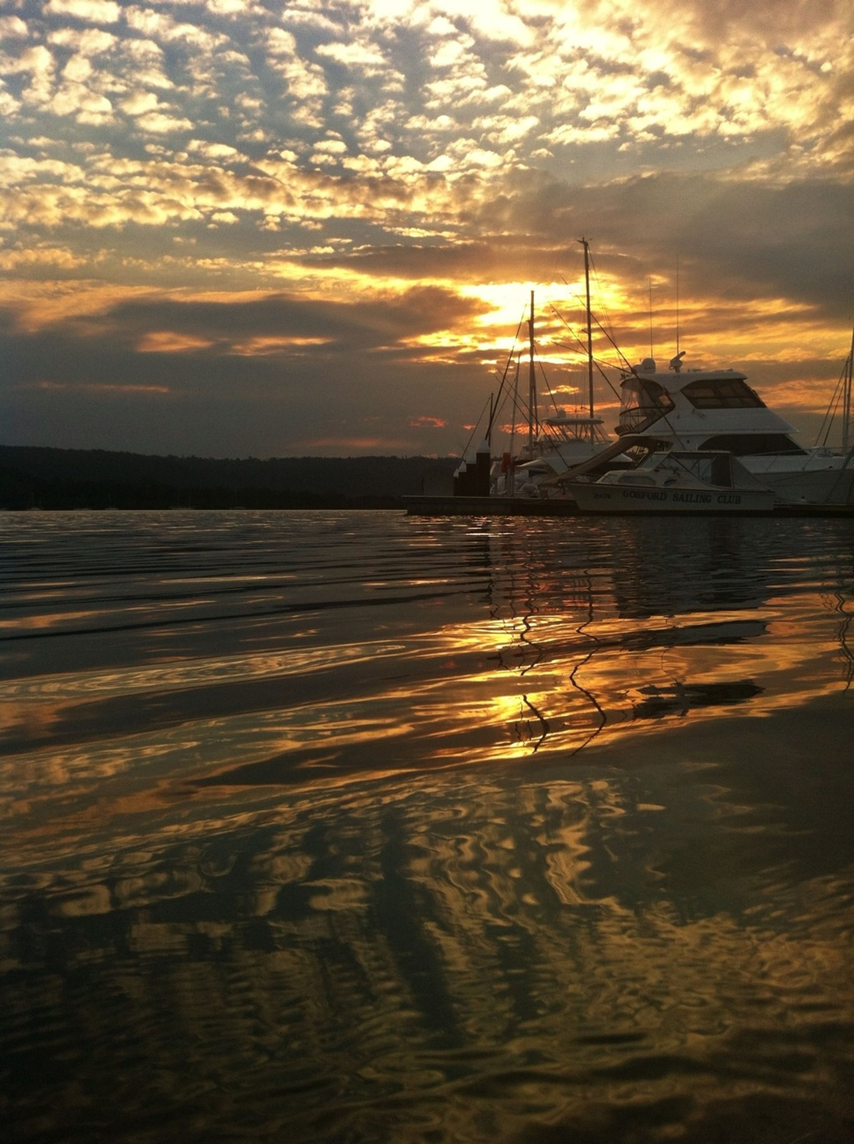 sunset, water, orange color, sky, sea, scenics, silhouette, beauty in nature, reflection, sun, waterfront, cloud - sky, tranquil scene, tranquility, nature, idyllic, nautical vessel, transportation, built structure, outdoors