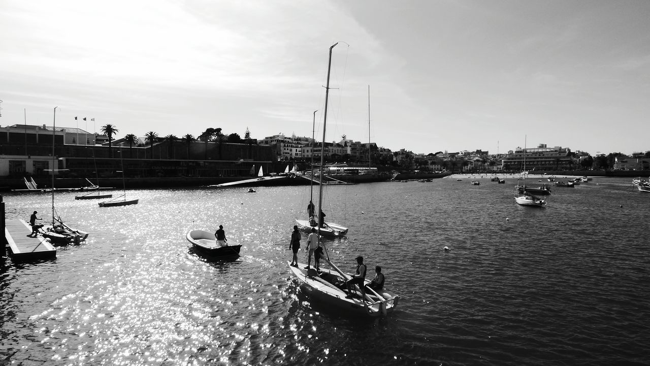 nautical vessel, transportation, architecture, water, mode of transport, building exterior, built structure, waterfront, outdoors, day, sky, river, harbor, moored, real people, city, mast, nature, gondola - traditional boat