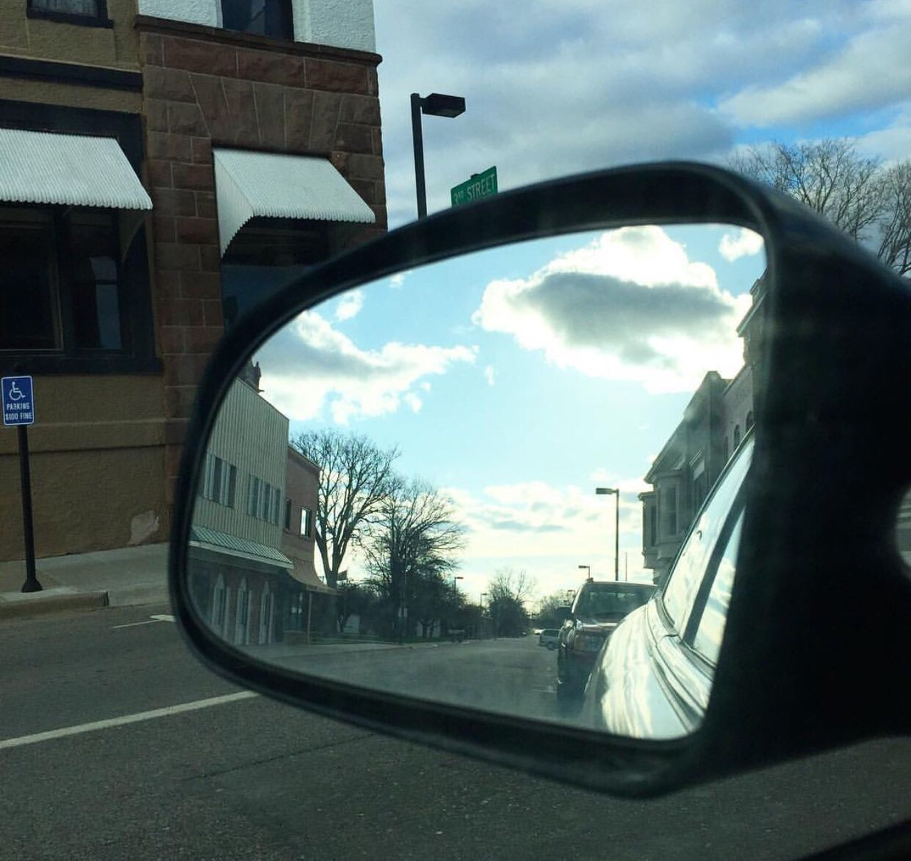 sky, architecture, built structure, transportation, car, building exterior, road, day, window, land vehicle, cloud - sky, side-view mirror, no people, city, tree, outdoors, close-up