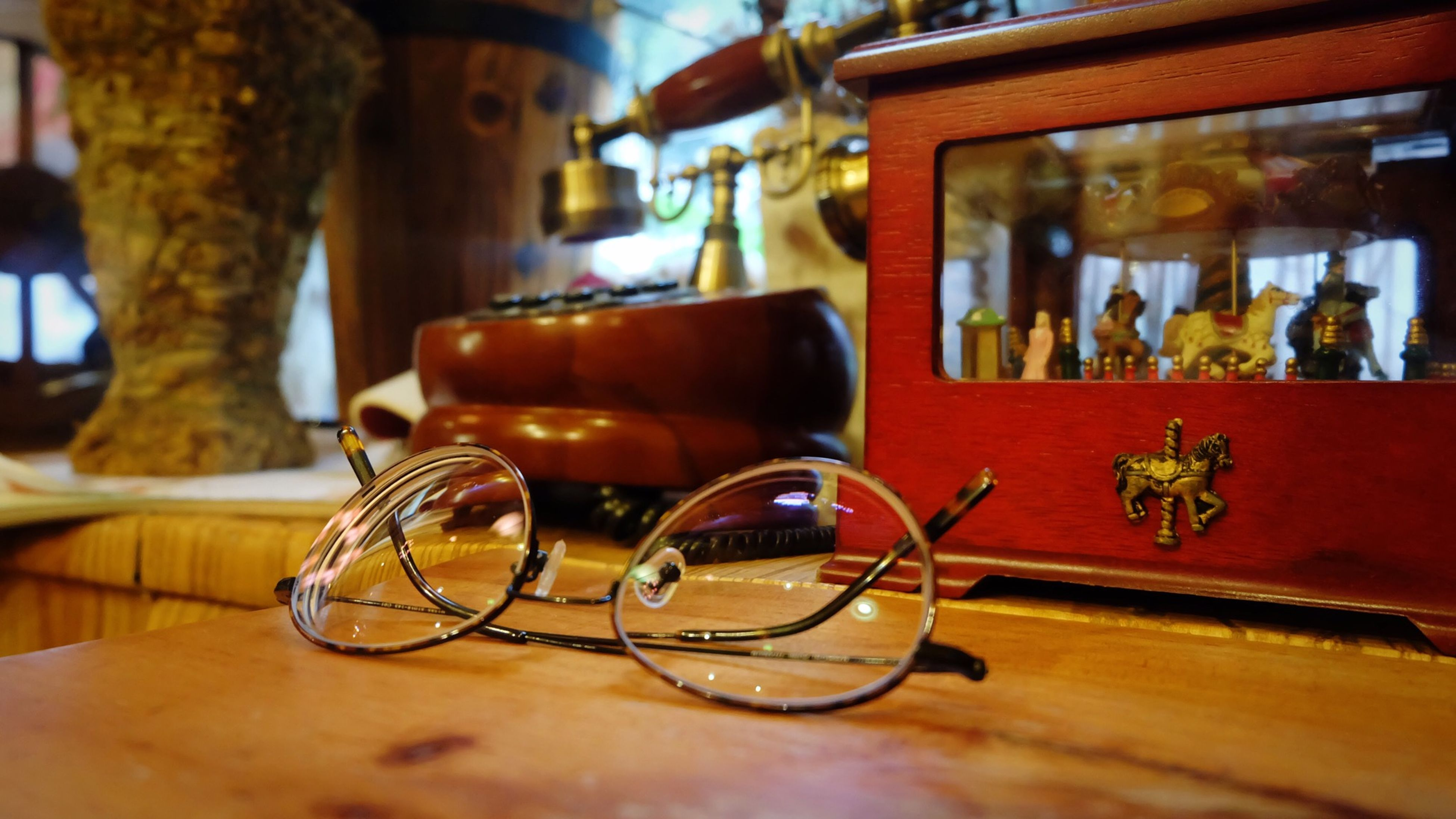table, focus on foreground, indoors, still life, architecture, built structure, close-up, old-fashioned, wood - material, selective focus, building exterior, window, no people, day, potted plant, glass - material, home interior, house, hanging, antique